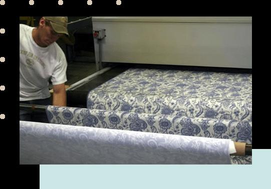 man arranging textiles