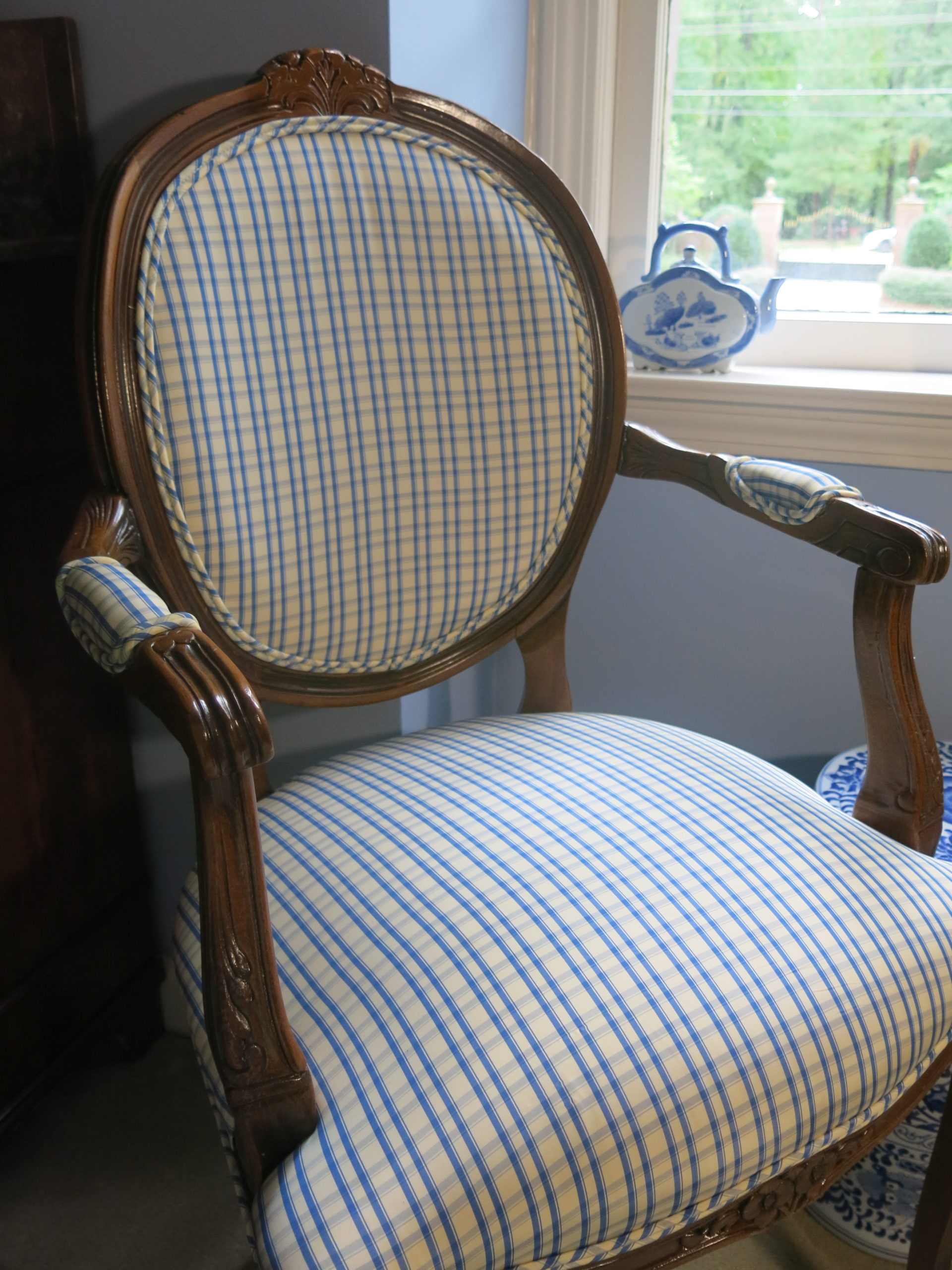 vintage chair with checkered pattern covers